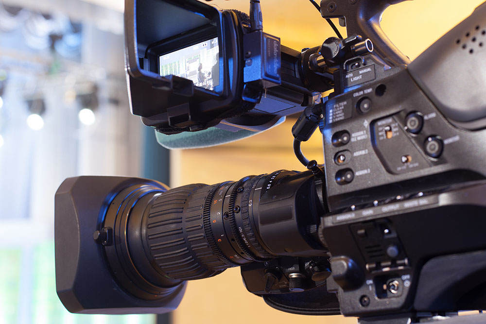 Professional digital video camera. Providing IMAG services in general session.